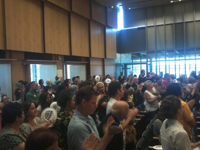 The crowd in City Council chambers erupts in applause as the Council passes the paid sick leave ordinance by a vote of 8-1