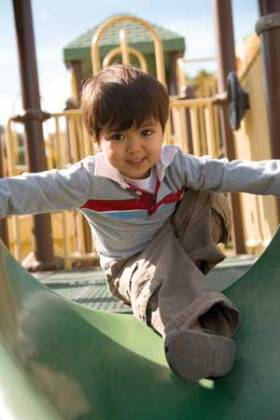 little-boy-on-slide